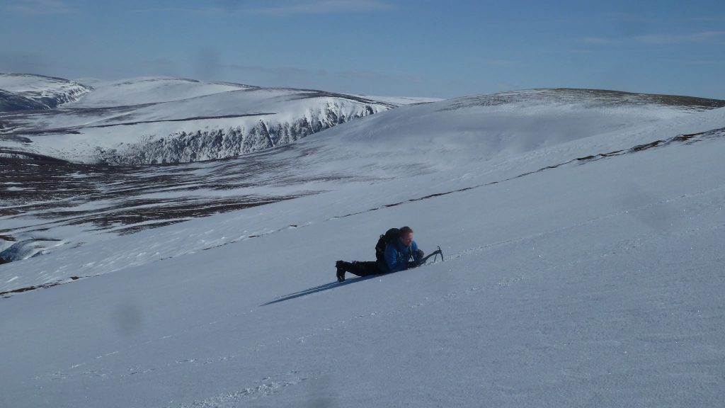 Alastair practising his ice axe skills